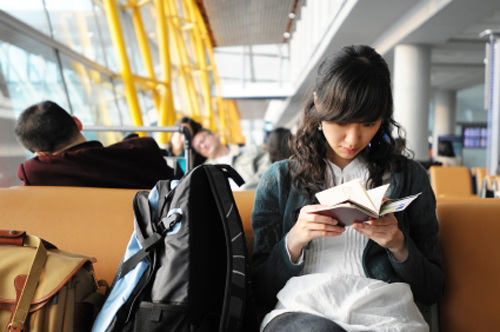 girl-waiting-in-airport-iStock-9140-4822