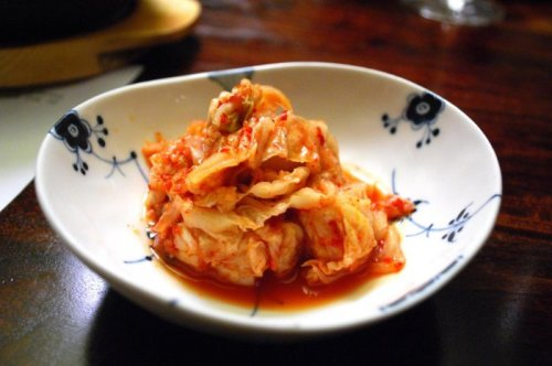KimchiA staple of the North Korean diet, usually consumed daily, kimchi is a fermented dish consisting of cucumbers or cabbage soaked in brine made from chiles, garlic, and ginger, and sometimes made with bean paste.