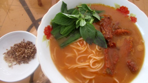 Color red peppers in a bowl noodle always makes customers feel excited Photo: Guo Duy Thinh