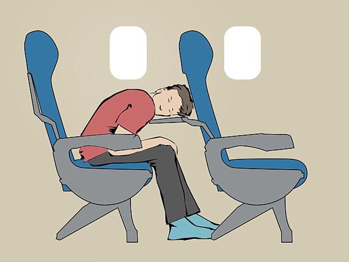 10 tư thế giúp bạn ngủ thoải mái trên máy bay