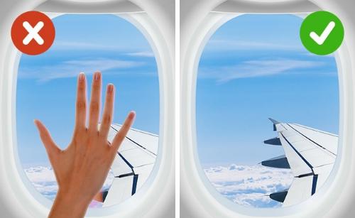 Không nên dựa hay đụng chạm lên cửa sổ máy bay vì đây cũng là nơi chứa nhiều vi khuẩn. Ảnh: top5ivez.