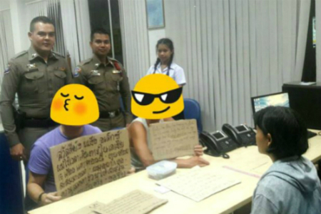 Hai người đàn ông cầm giấy xin tiền về đồn cảnh sát để điều tra. Ảnh: Nation.
